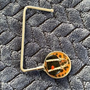 Decorative purse holder on flat surfaces